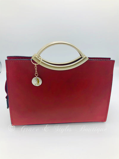 Leather evening bag with metal handles in red