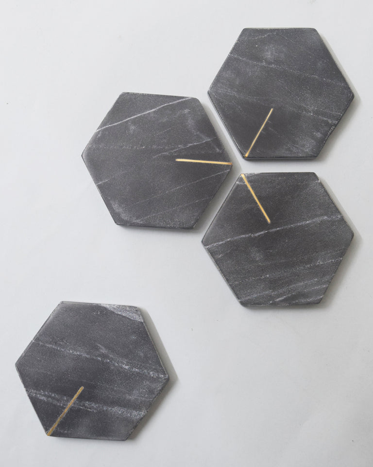 Load image into Gallery viewer, Black Hexagonal Marble Coasters with Brass Inlay - Set of 4