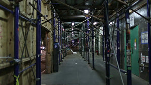 passageway under scaffolding bars on noisy night with ambient noise of street in NYC