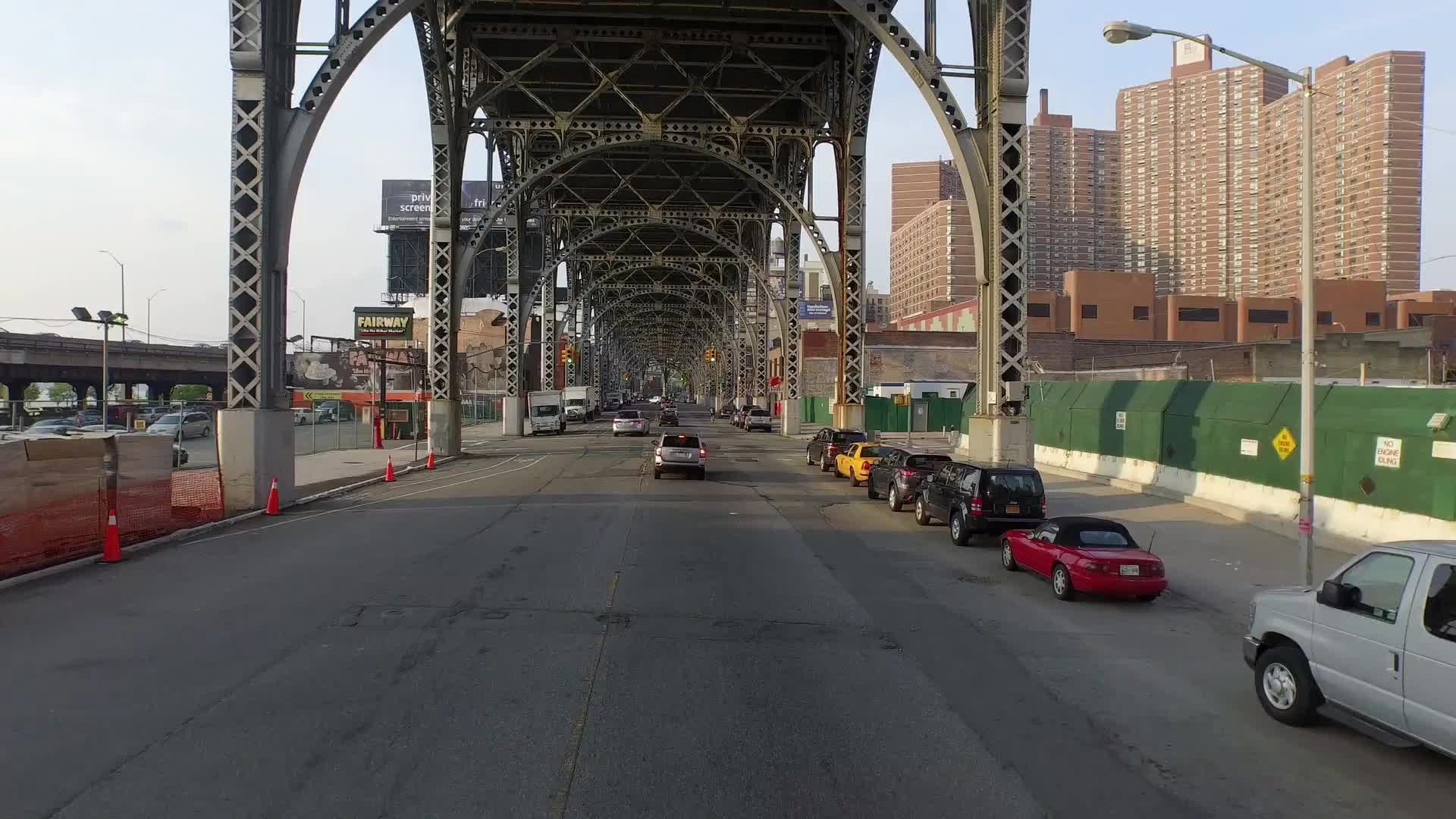 moving underneath elevated subway track on 125th st in Harlem NYC