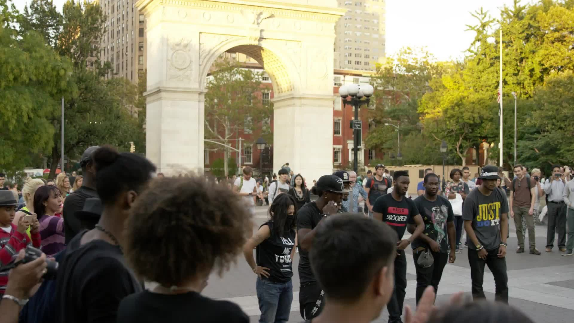 break dancing in Washington Square Park summer breakdancer spinning on hands slow motion 4K NYC