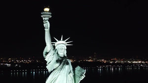 Statue of Liberty aerial circling at night in 1080