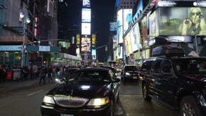 Uber limousine car driving in Times Square at night in NYC