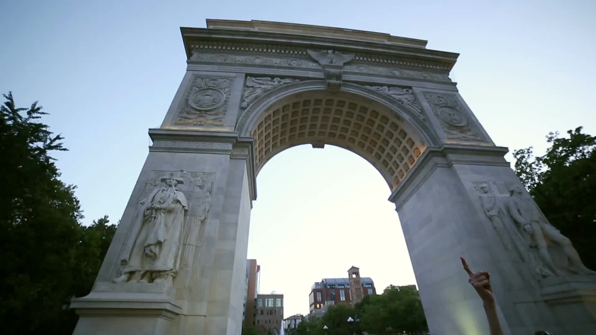 man arguing with pro-Palestinian protestor under arch in Washington Square Park in NYC