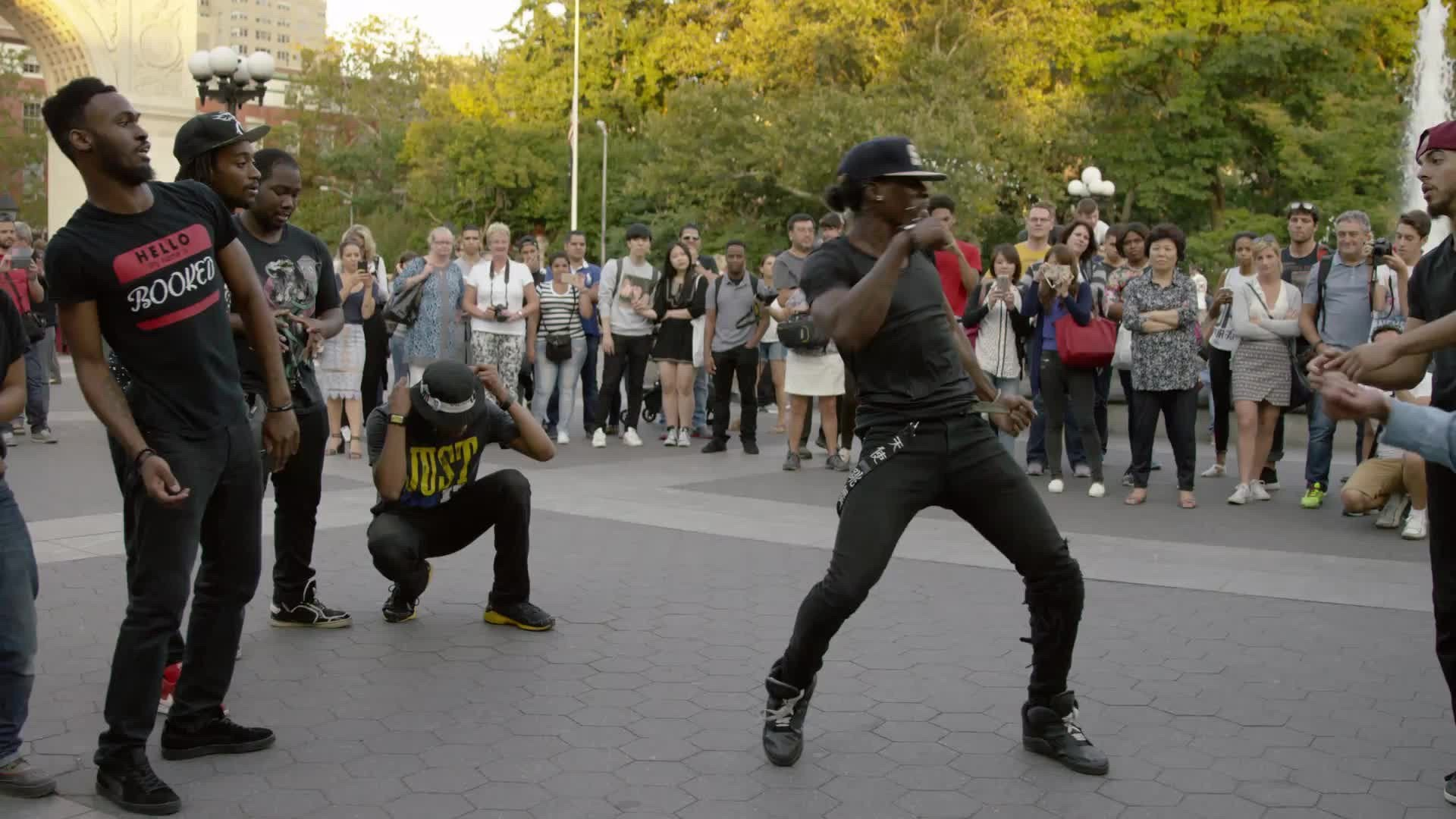 dancers in Washington Square Park summer slow motion New York City 4K