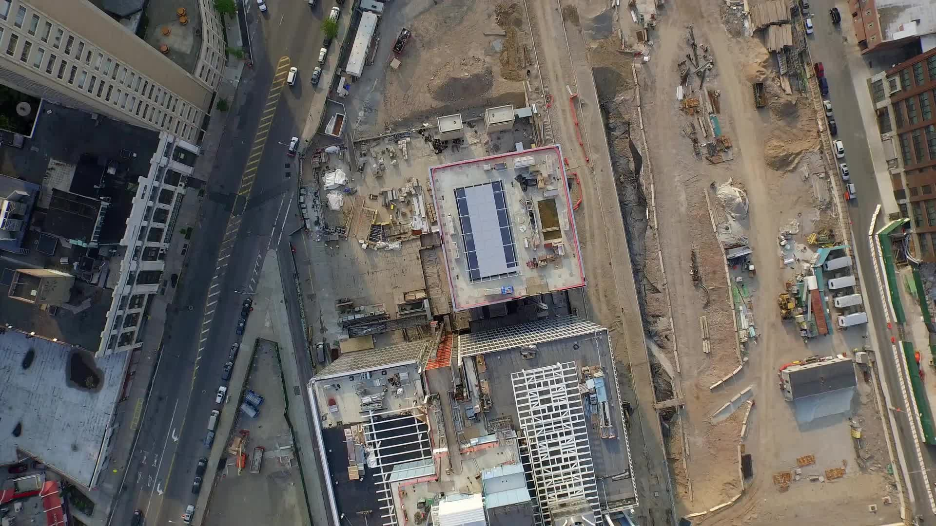 Harlem construction site over Uptown Manhattan 4K NYC