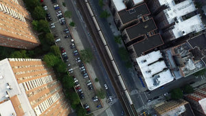 aerial over 1 train elevated track and red brick housing projects in Harlem NYC
