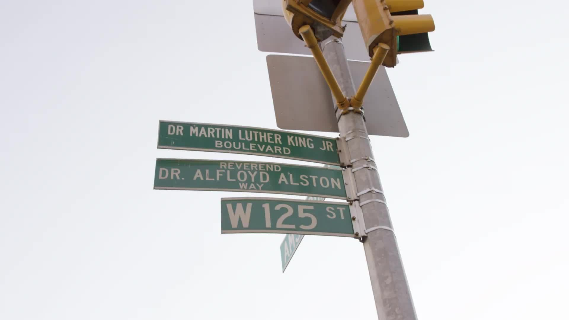 125th street Martin Luther King Jr Blvd sign in Harlem Uptown Manhattan close-up 4K NYC