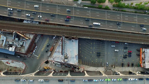 aerial of cars driving in traffic on West Side Highway by Hudson River over Manhattan NYC