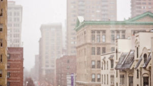 snowy winter day snowing in Manhattan window view snow storm - blizzard falling daytime