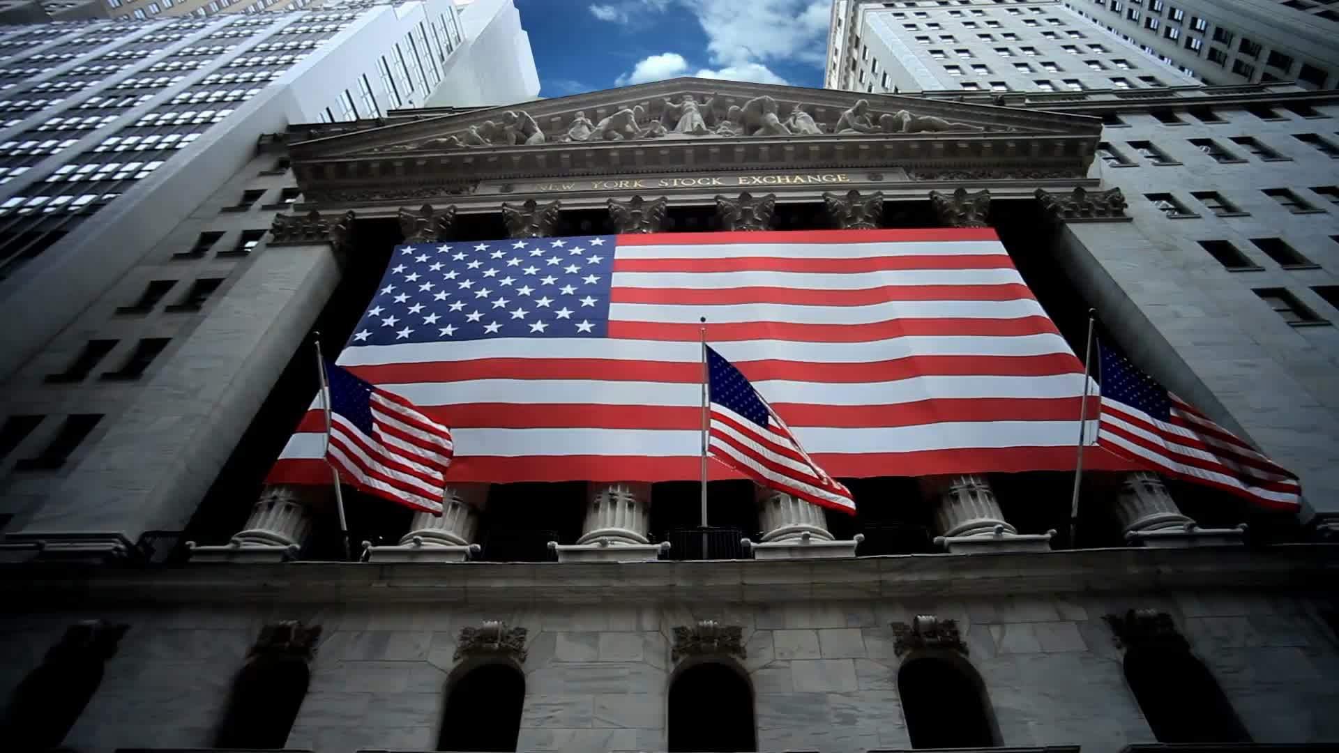 New York Stock Exchange Time-lapse with American flags on Wall Street in Downtown Manhattan New York City NYC in 1080 HD