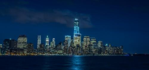 Freedom Tower skyline Downtown Manhattan at night in New York City NYC and East River