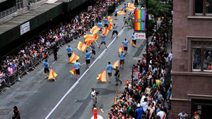 gay pride parade on lower 5th ave - overhead view of crowded street - people marching with LGBT rainbow flags