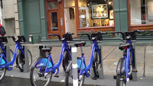 driving by CitiBike docking station on street - blue bicycles parked