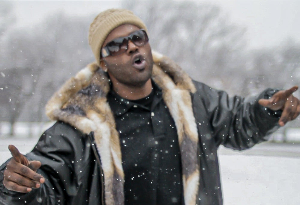 Still from O Da Addic music video during snowstorm