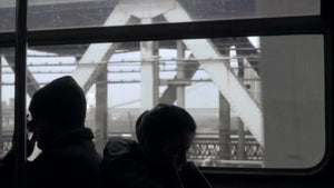 silhouettes of passengers riding B Train crossing Manhattan Bridge - dark interior in NYC