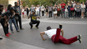breakdancer performing - dancing in Washington Square Park - breakdancing on summer day