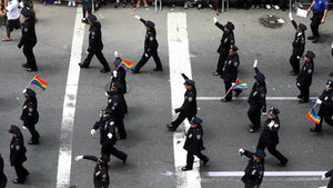 NYPD police officers marching in uniform at Gay Pride Parade in NYC