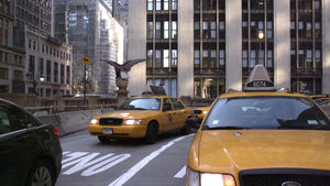 taxis driving - cabs turning through Park Ave underpass in MetLife Building in Midtown Manhattan