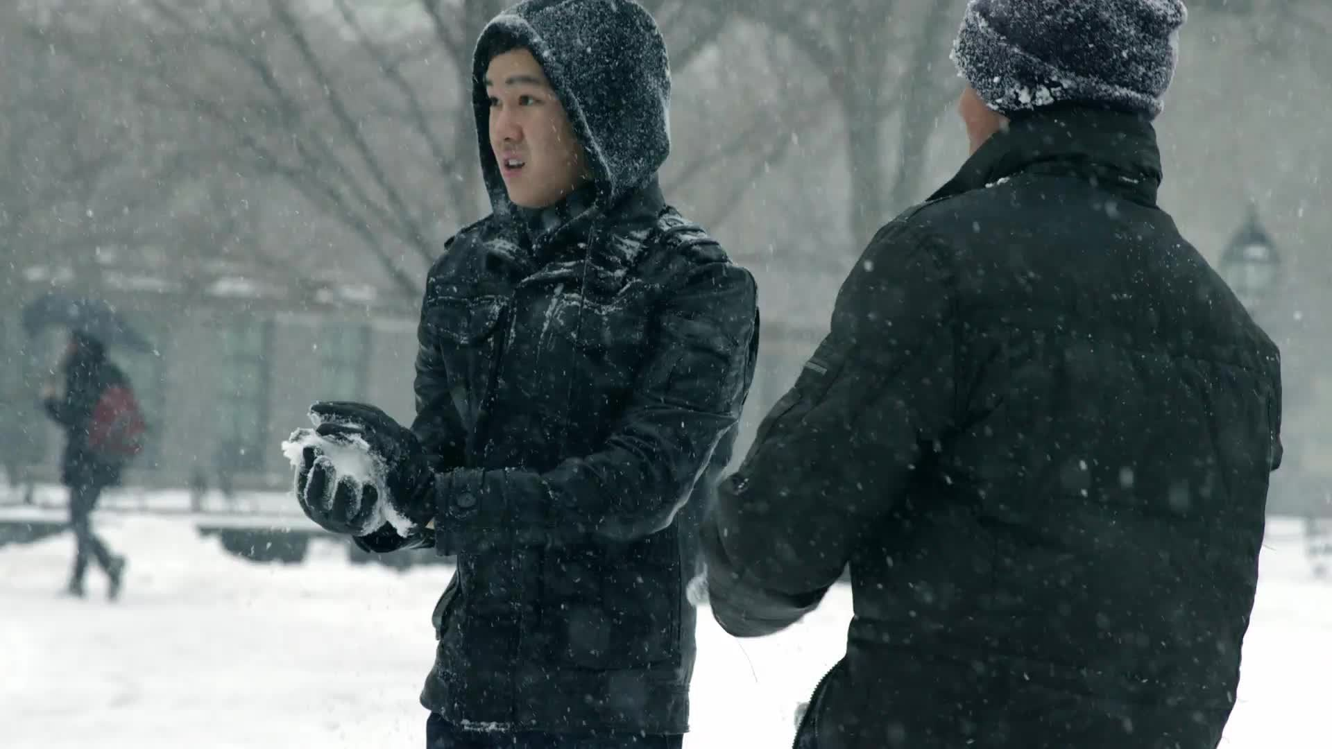 guys throwing snowballs in winter blizzard storm, snowing in Washington Square Park - Asian and Indian man throw snow ball in snowball fight slow motion 4K