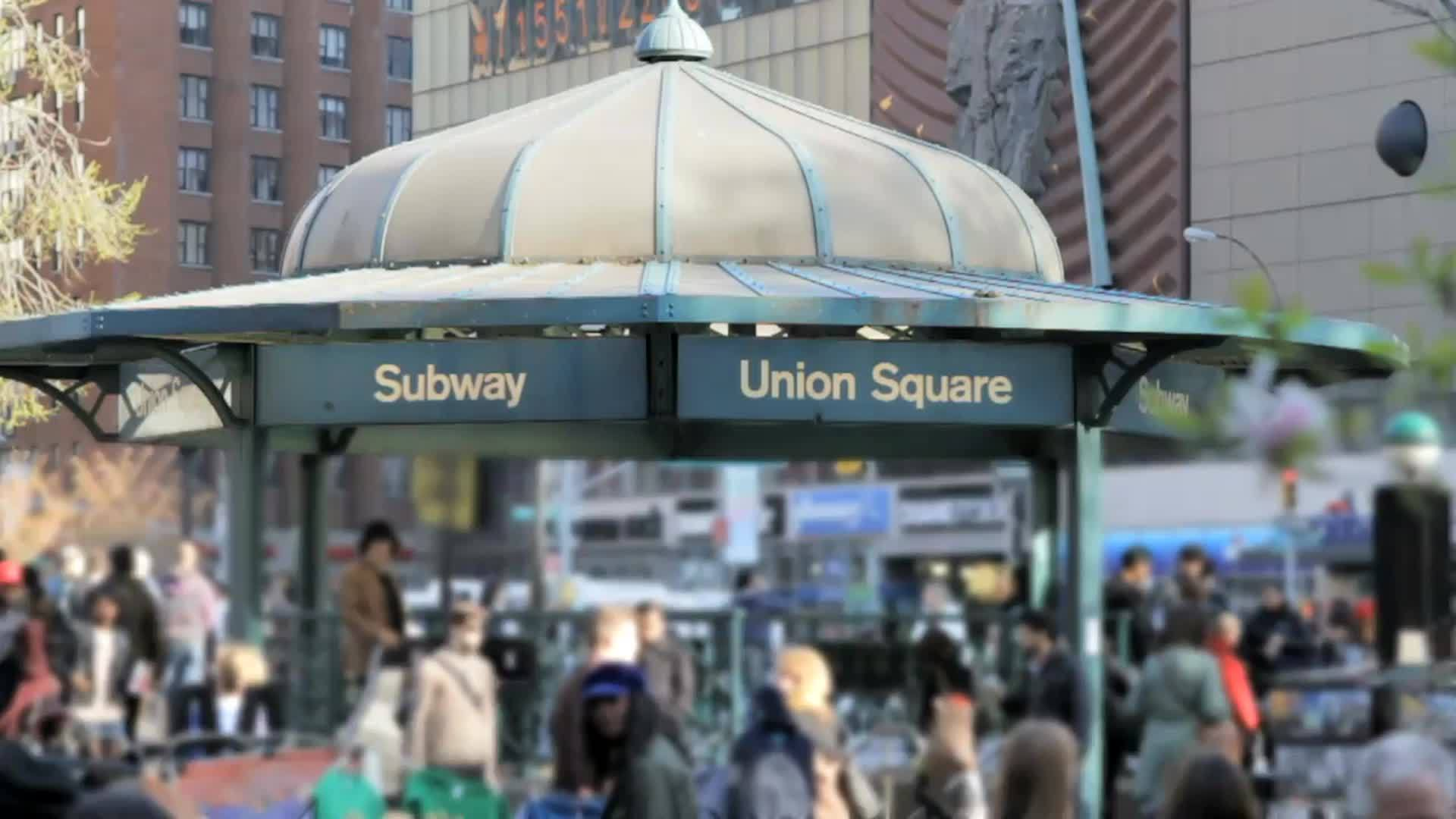 Union Square subway train station sign crowded entrance with people outside