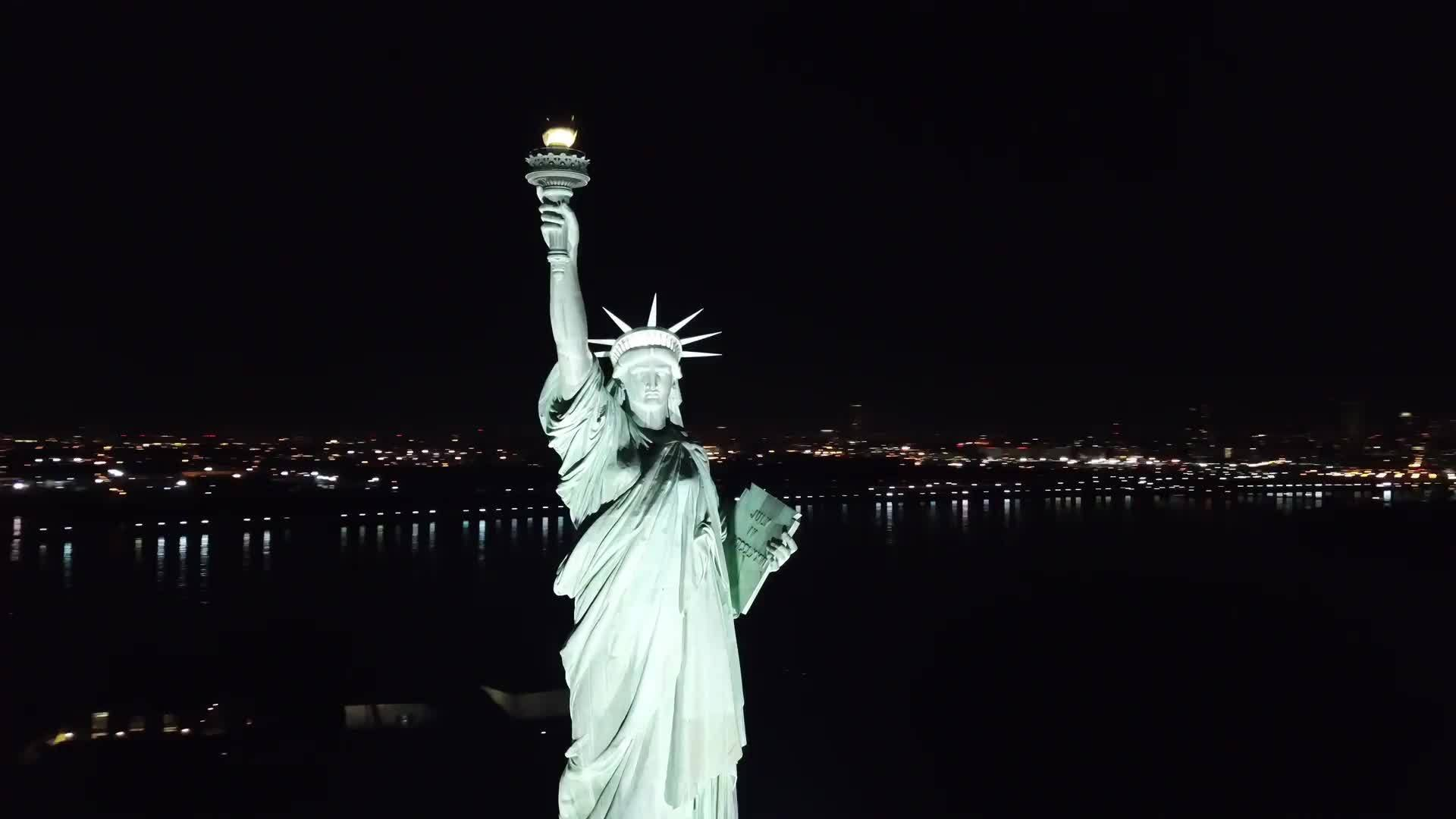 Statue of Liberty aerial circling night 4K and 1080 H