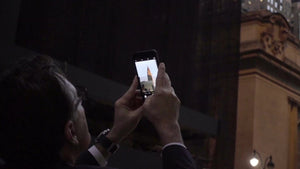 tourist man taking smartphone picture of Chrysler Building in Manhattan