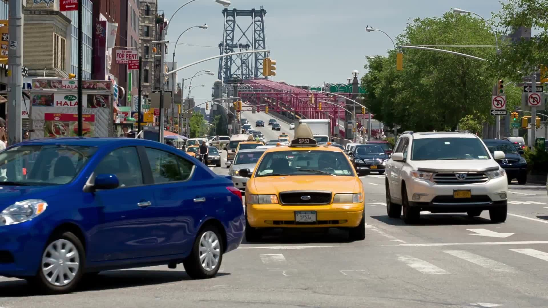cars in traffic exiting Williamsburg Bridge in Manhattan's Lower East Side on summer day