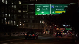 sign for Holland Tunnel on Varick Street in Lower Manhattan at night in NYC