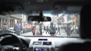 people crossing street - crosswalk from driver pov in super slow motion in NYC on winter day