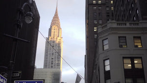 Chrysler Building street view from 42nd Street and Madison Avenue sign, tilting down to busy crowded Midtown Manhattan corner, NYC 1080 HD