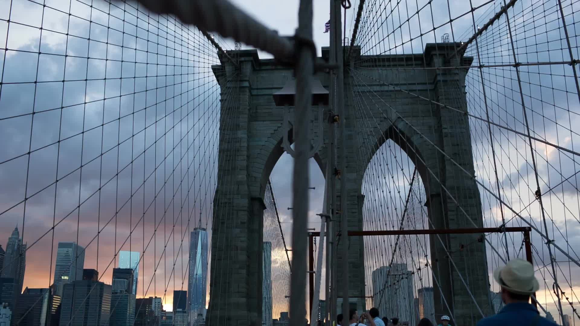 Brooklyn Bridge at beautiful sunset on summer evening with Manhattan skyline in NYC