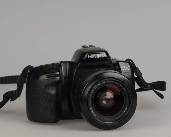 Minolta Maxxum 400si 35mm film SLR camera featuring a 28-80mm lens