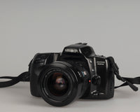 Minolta Maxxum 400si 35mm film SLR camera featuring a 28-80mm lens; front view