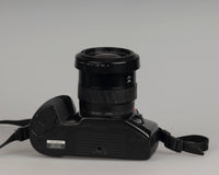 Minolta Maxxum 400si 35mm film SLR camera featuring a 28-80mm lens; bottom view