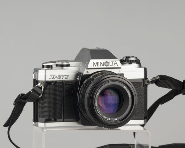 The Minolta X-370 is the simpler little brother to the famed X-700 manual focus 35mm camera