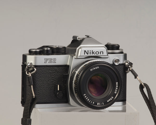 Nikon FE2 35mm film SLR camera with Nikkor 50mm f1.8 lens. Available at New Wave Pool, Montreal.
