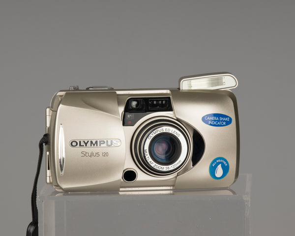 The Olympus Stylus 120 (aka Olympus mju-III 120) is advanced point-and-shoot film camera from 2003. It features a sophisticated lens with aspherical and ED glass elements.
