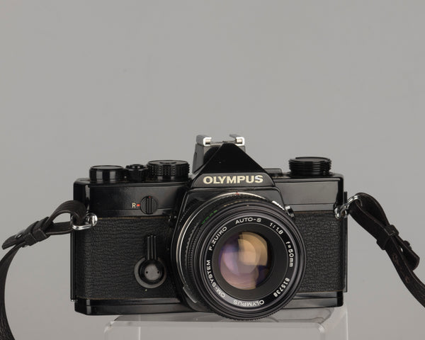 Olympus OM-1 35mm film SLR w/ Zuiko 50mm f1.8 lens and ever-ready case