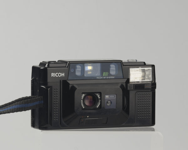 The Ricoh FF-3 AF is quality point-and-shoot 35mm from the early 1980s built around a excellent and quite sophisticated 35mm f3.2 Rikenon lens (5 elements in 5 groups).