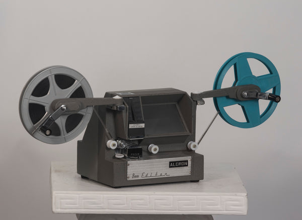Alcron 8mm movie viewer/editor shown with reel