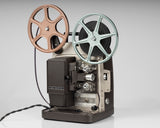 Bell and Howell Model 346 super 8 projector; front angle view with movie reels