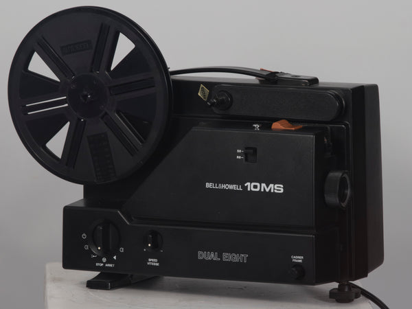 Bell and Howell 10MS dual 8mm & Super 8 projector. Shown with takeup reel.