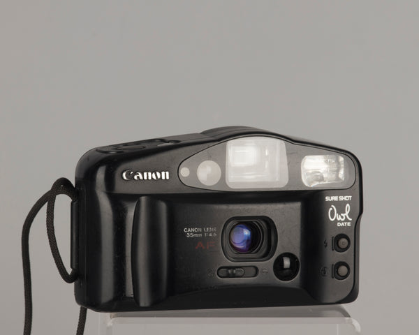 The Canon Sure Shot Owl Date is a 35mm point-and-shoot camera with a 35mm focal length lens