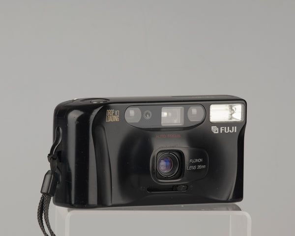 The Fujifilm DL-80 is an auto-focus compact film camera with a fixed 35mm lens