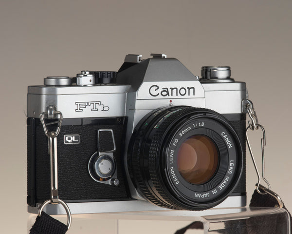 Canon FTb 35mm SLR camera with Canon FD 1:1.8 lens. Angled front view