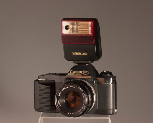 Canon T50 camera + Speedlite flash