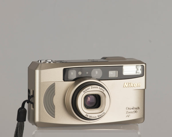 The Nikon One Touch Zoom 90 AF is a compact 35mm film camera with a 38-90mm lens with macro capability