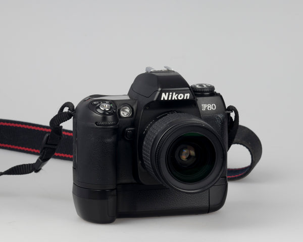 Nikon F80 35mm film SLR with AF Nikkon 28-80mm lens and battery grip