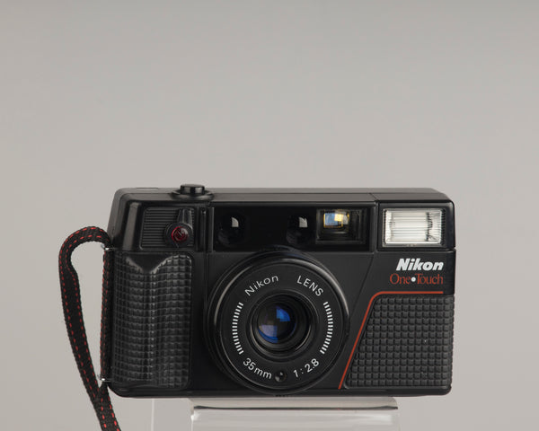 The Nikon One Touch (aka L35AF2) is a classic 1980s 35mm point-and-shoot camera with a sharp 35mm f2.8 lens